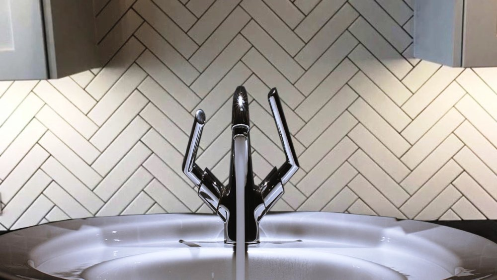 design backsplash with large white herringbone tiles